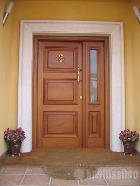 Como instalar una puerta exterior for Modelos de puerta de madera para casa