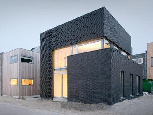 Funciones y tipos de fachadas for Fachadas de almacenes modernos