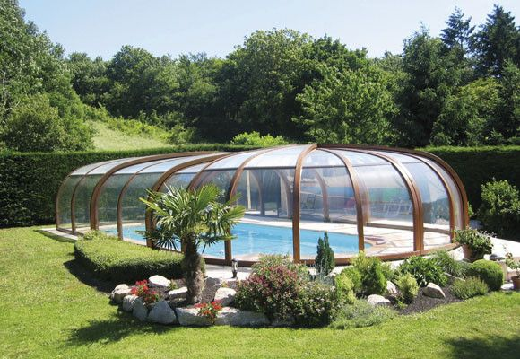 Instalaciones en cubiertas de piscina for Fotos de casas con piscina interior