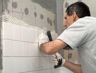 Instalacion de azulejos for Bathroom floor repair contractor