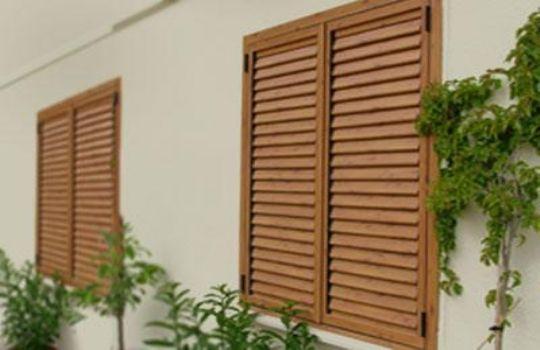 Ventanas aluminio imitacion madera fotos presupuesto e for Ventanas de aluminio color madera precios