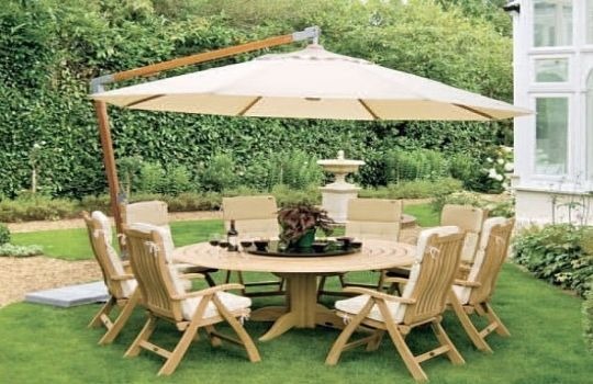 Mesas con sombrilla fotos presupuesto e imagenes for Decoracion mesas de jardin