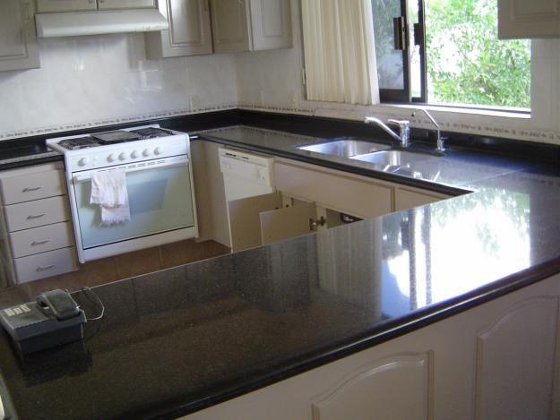Topes de granito para tu cocina for Cocinas de cemento y ceramica