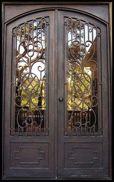Fotos de puertas de hierro forjado for Modelos de puertas principales para casas