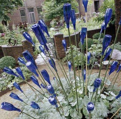 Como decorar un jard n con botellas de vidrio - Casetas para el jardin ...
