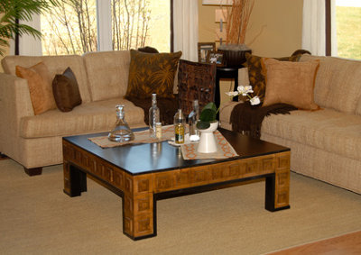 Living room setting with couch and coffee table done in earth tones