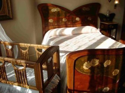 Dormitorios mixtos para padres y bebes for Como decorar un dormitorio grande