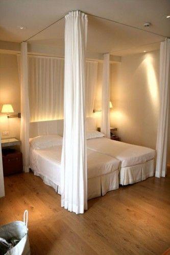 Dormitorio matrimonial con camas separadas