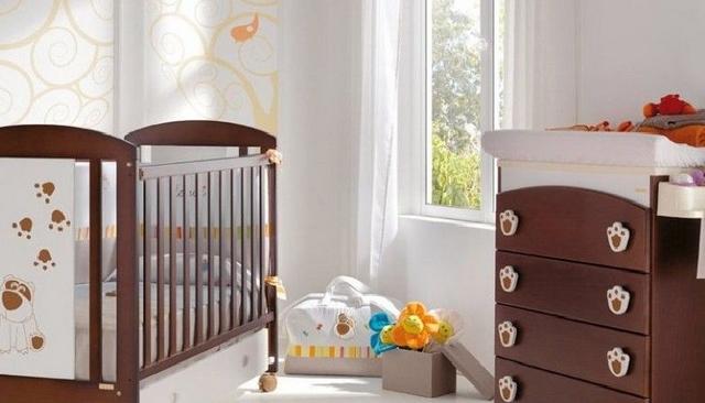 Decoracion de habitacion de bebes con huellitas de animales 1
