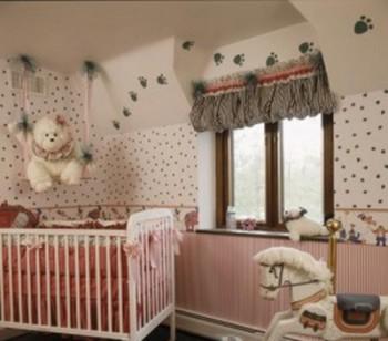 Decoracion de habitacion de bebes con huellitas de animales