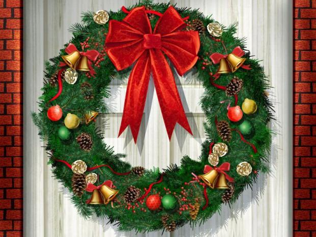 Decorando la puerta del hogar para la navidad