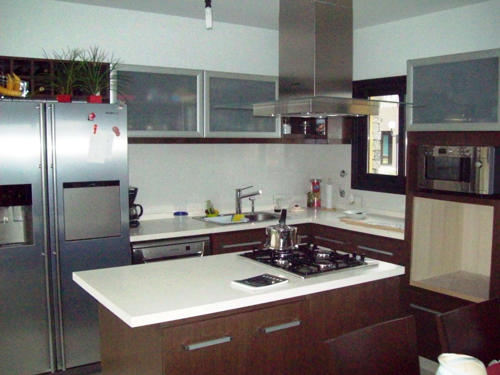 Estilos el uso de las islas en la cocina for Cocinas integrales con isla pequenas